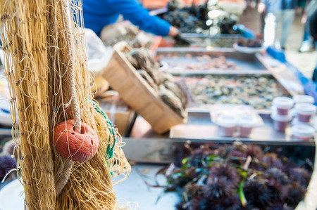 the local characteristics: Close up view of a fishing net on the boat of a fish seller in the public fish market of Catania