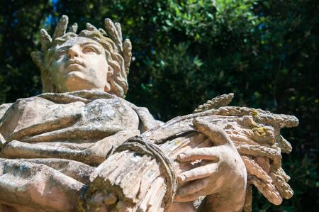 representations: Ceramic statue of the summer with a woman holding a bundle of wheat, public gardens in Caltagirone, Sicily