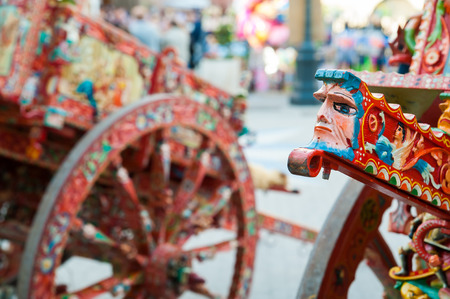 folkloristic: CLose up view of a colorful detail of a typical sicilian cart