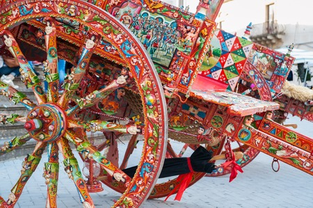 characteristic: View of a typical colorful sicilian cart with its characteristic decorations