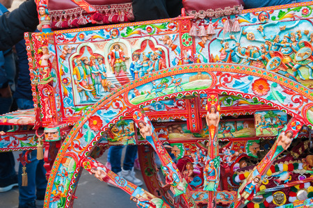 folkloristic: Close up view of a colorful wheel of a typical sicilian cart Stock Photo