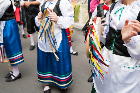 folkloristic: Girl with a typical regional dress holding a colored tambourine during a folkloristic show in Sicily