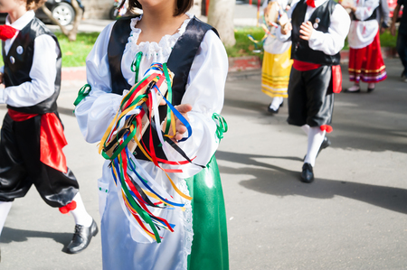 folkloristic: Girl with a typical regional dress playing a colored tambourine during a folkloristic show in Sicily Stock Photo