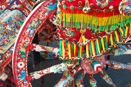 folkloristic: Close up view of a colorful wheel of a typical sicilian cart with a colored ornament