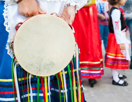 folkloristic: Folkloristic sicilian tambourine held by a a girl with a typical regional dress Stock Photo