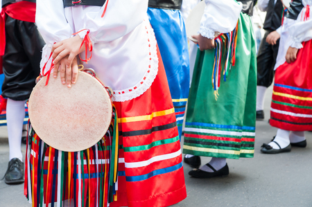 folkloristic: Folkloristic sicilian tambourine held by a a girl with a typical regional dress  during a regional show Stock Photo