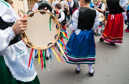 folkloristic: Girl with a typical regional dress playing with colored tambourine During a folkloristic show in Sicily Stock Photo