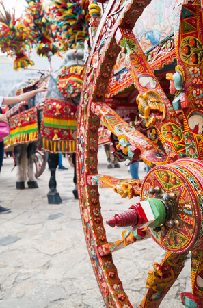 folkloristic: Close up view of a colorful wheel of a typical sicilian cart during a folkloristic show