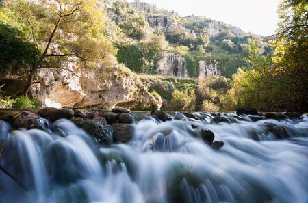 canyon walls: Anapo river flowing in the Pantalica valley, Sicily, and the walls of the canyon in the background