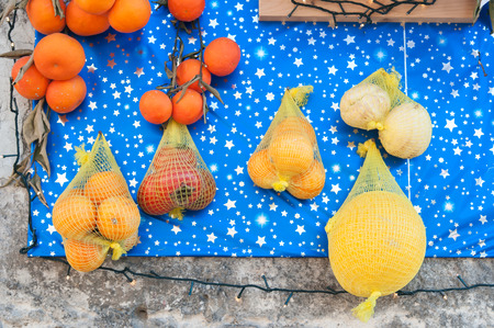 the local characteristics: Rural christmas altar made with different kinf of fruits and food arranged along the streets of Lentini, Sicily