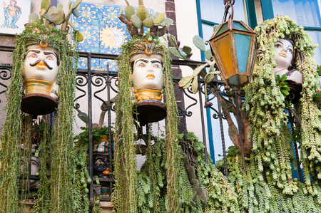 planters: Some ornamental flowered pottery planters on a balcony along the streets of Taormina, Eastsicily Stock Photo