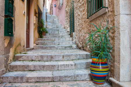 characteristic: A characteristic narrow alley of Taormina, Eastsicily, with some typical colored ceramic vases