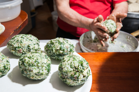 modelled: Some typical just modelled sicilian rice arancini with spinach and jam