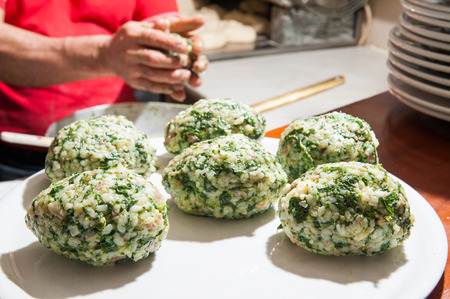Some typical just modelled sicilian rice arancini with spinach and jam