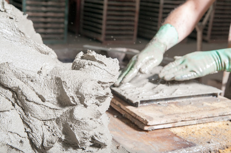 modelled: Mixture of clay and lavic sand ready to be modelled to make red bricks