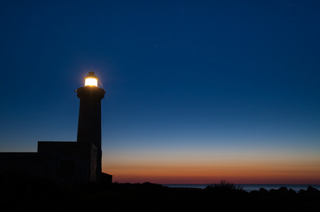 nightfall: The lighthouse of Syracuse before the dawn against a starry sky