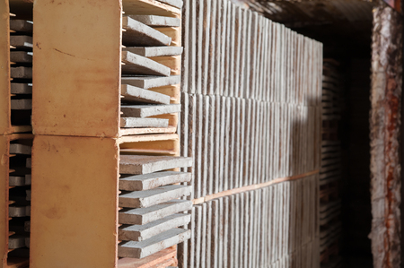 brick kiln: Just modelled square tiles before being fired into the kiln of a red brick workshop