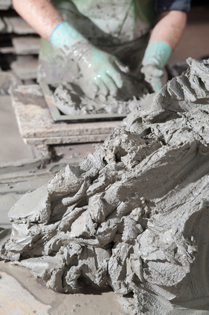 modelled: Mixture of clay and lavic sand of mount Etna ready to be modelled to make red bricks
