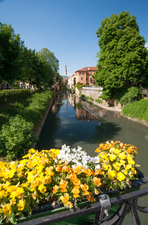 springy: Flowered balcony of Monte Furo in Vicenza, Italy, with a view of retrone river and the clock tower in the distance Stock Photo