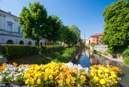 Flowered balcony of Monte Furo in Vicenza, Italy, with a view of retrone river and the clock tower in the distance Stock Photo