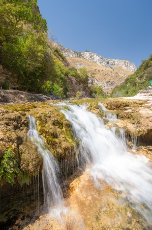 The natural reserve Cavagrande, Sicily, with a view of a smal and fall of the canyon