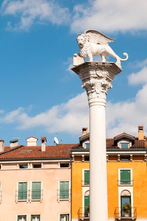 View of the column of the lion and some typical palaces in the main square of Vicenza