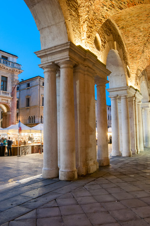 View of the columns and arches of the Palladian Basilica in Vicenza at dusk