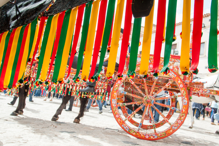 Close up view of a colorful harness of a typical sicilian cart during a folk festival