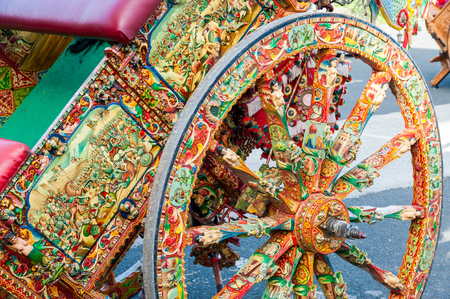 folkloristic: Close-up view of a colorful wheel of a typical sicilian carts During a folkloristic show Stock Photo