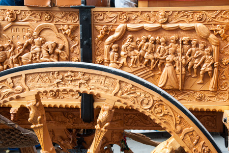 marqueteria: Close-up view of a wooden carved wheel of a typical sicilian cart during a folkloristic show