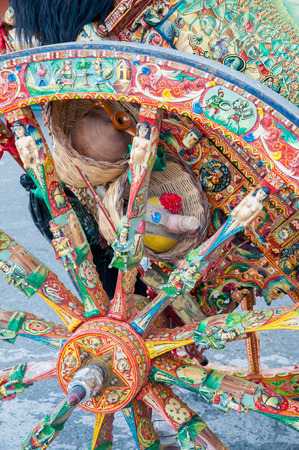 folkloristic: Close-up view of a colorful wheel of a typical sicilian cart during a folkloristic show Stock Photo