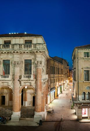 The Capitaniato palace by night seen from the facing Palladian basilica, Lords square, Vicenza