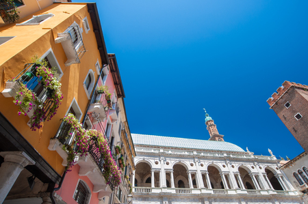 The palladian Basilica and some colored palaces of the town center of Vicenza seen from Piazza delle Erbe (Herbs Square) Фото со стока - 66255274