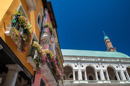 The palladian Basilica and some colored palaces of the town center of Vicenza seen from Piazza delle Erbe (Herbs Square)