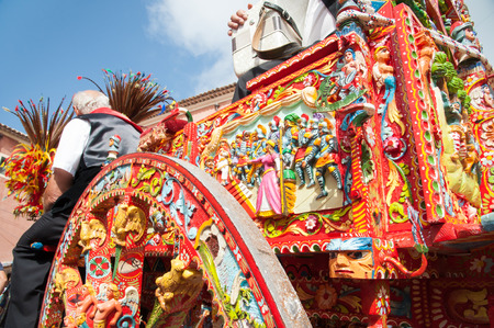 medios de transporte: Partial view of a typical colorful Sicilian cart during a folk festival