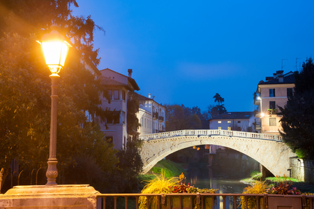 Night view of the old San Michele bridge seen from the balcony of San Paolo bridge, Vicenza, Italy