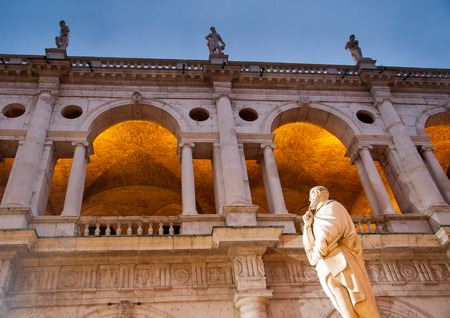 Night view of the statue of the famous Renaissance architect Palladio and part of the Palladian basilica, Vicenza Stock Photo