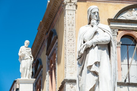 spiritual architecture: The statues of the famous italian poet Dante Alighieri in Lords Square, Verona