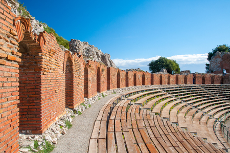 Section of the upper external arcade of the greek theater and a view of its bleachers, Taormina, East Sicily