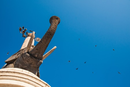 Bottom view of the famous lava stone statue of an elephant and its obelisk in Catania, Sicily, the symbol of the town