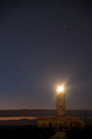 Lighthouse against a starry sky Banco de Imagens