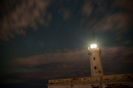Lighthouse against a starry sky Imagens