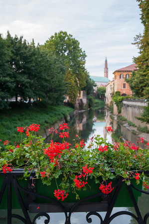 View of Retrone river and the clock tower of Vicenza, Italy, seen from Furo bridge Stock Photo - 101845762