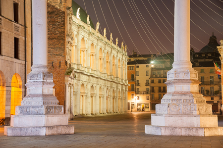 The famous palladian basilica by night, Lords Square in Vicenza and the basis of the two columns