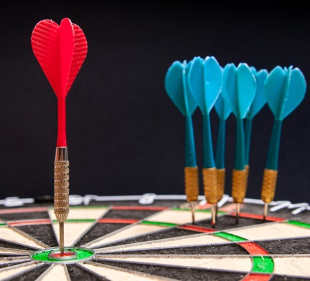 Close-up view of a red dart on the bullseye Stock Photo