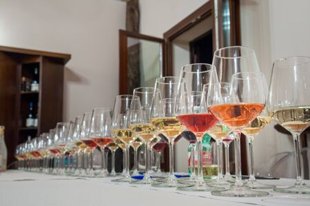 Row of glasses of wine on a table during a degustation event