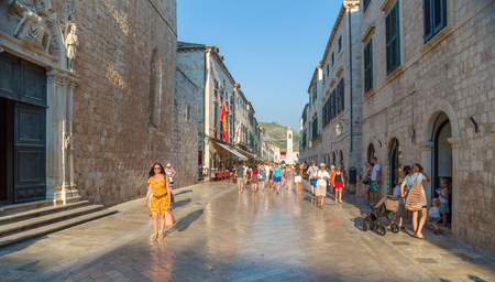 croatia dubrovnik: DUBROVNIK, CROATIA - JUL 17, 2015: Unidentified tourists on the street of the old town of Dubrovnik, Croatia. Dubrovnik is a UNESCO World Heritage site