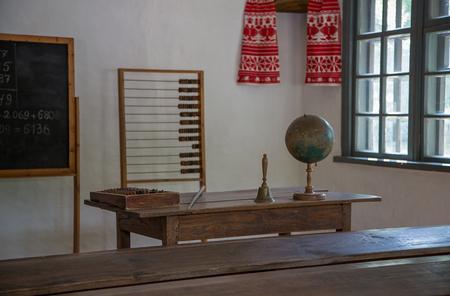 Classroom in the old school. Teachers desk.
