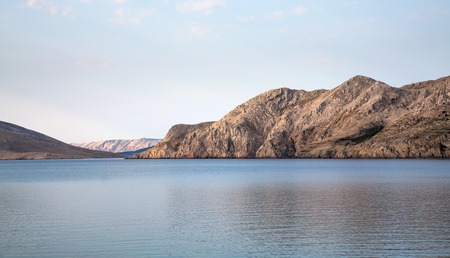 enclosed: Sea lagoon enclosed by mountains early morning