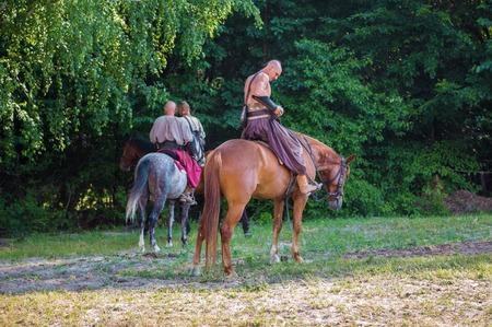 drover: KIEV, UKRAINE - JUN 21, 2015: Zaporizhzhya Cossacks on horseback against a background of forest Editorial